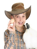 Chicken or Egg. A smiling boy holds a chicken and an egg royalty free stock images