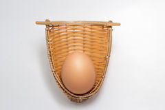 Chicken egg in bamboo weave basket on white Stock Images