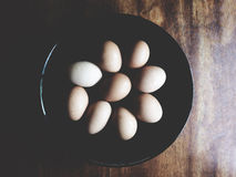 This is chicken egg in the black plate above wooden desk, soft t Stock Photo