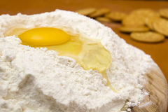 Chicken egg in the flour Royalty Free Stock Image