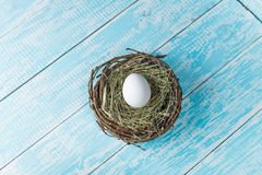 Chicken egg in a nest. Chicken eggs in the nest decorated background Provence Stock Images