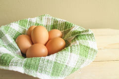 Chicken egg and relate mat on basket Stock Photo