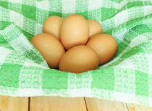 Chicken egg and relate mat on basket Royalty Free Stock Photo