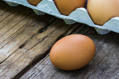 Chicken egg on wood and chicken egg in panel eggs Royalty Free Stock Photo
