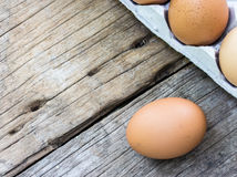 Chicken egg on wood and chicken egg in panel eggs Royalty Free Stock Image