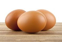 Chicken egg on a wooden table. Isolated on a white background Stock Photo