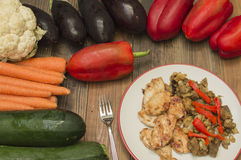 Chicken with Eggplant. Stewed chicken with eggplant, vegetables on the table Royalty Free Stock Images