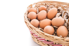 Chicken eggs in the bamboo basket. Closeup of Chicken eggs in the bamboo basket and  isolated on white background Royalty Free Stock Images