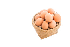 Chicken eggs in the bamboo basket. Closeup of Chicken eggs in the bamboo basket and  isolated on white background Royalty Free Stock Image