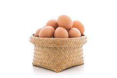 Chicken eggs in the bamboo basket Royalty Free Stock Images