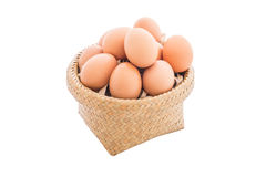 Chicken eggs in the bamboo basket. Closeup of Chicken eggs in the bamboo basket and  isolated on white background Stock Photos