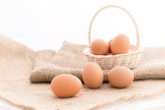 Chicken eggs in the bamboo basket Royalty Free Stock Photos