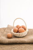 Chicken eggs in the bamboo basket Stock Photo