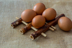 Chicken eggs on bamboo pad Royalty Free Stock Photo