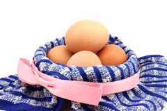 Chicken eggs in a basket Royalty Free Stock Photo