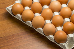 Chicken eggs in a basket among the hay Stock Images