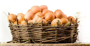 Chicken eggs in basket isolated. Organic food royalty free stock photography