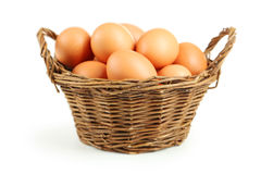 Chicken eggs in basket isolated on white. Stock Photos