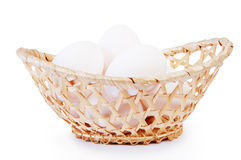 Chicken eggs in a basket Royalty Free Stock Image
