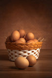Chicken eggs in the basket Royalty Free Stock Photo