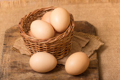 Chicken eggs in a basket Stock Photos