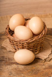 Chicken eggs in a basket Royalty Free Stock Photos