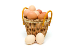 Chicken eggs in a basket on white background Stock Image