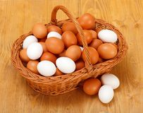 Chicken eggs in basket Stock Photos