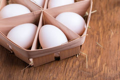 Chicken eggs in basket Royalty Free Stock Images