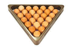 Chicken eggs in the billiard triangle. Fresh chicken beige eggs in the billiard triangle closeup Stock Images