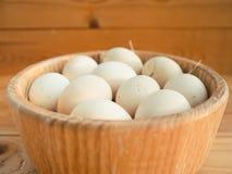 Chicken eggs in a bowl. Stock Photos