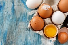 Chicken eggs in a box. On  a blue wooden background Stock Photography
