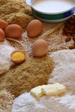 Chicken eggs with a broken egg and some beans and flour recipe Royalty Free Stock Photography