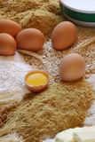 Chicken eggs with a broken egg and some beans and flour recipe.  Stock Photography