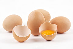 Chicken eggs with broken egg Stock Photo