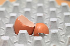 Chicken eggs of brown color in cardboard cells. Royalty Free Stock Photos