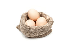 Chicken eggs in burlap sack  on white background Stock Image