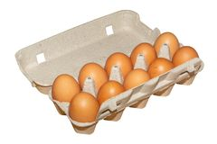Chicken eggs in a cardboard container stock photo