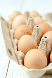 Chicken eggs in a cardboard tray Royalty Free Stock Images
