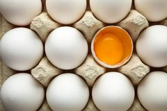 Chicken eggs in carton box as background royalty free stock photography