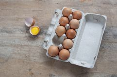 Chicken eggs in carton on wooden table. Eggs Yolk Cooking Top View. Food background stock photography