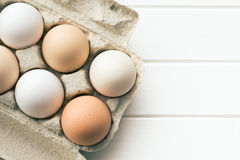 Chicken eggs in egg box Royalty Free Stock Images