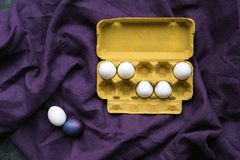 Chicken eggs in egg carton. On textile background royalty free stock photography