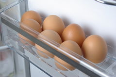 Chicken eggs in the fridge Stock Photos