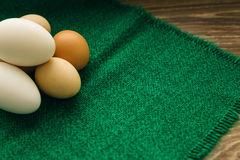 Chicken eggs on a green napkin Stock Photography