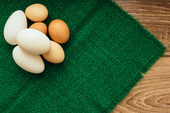 Chicken eggs on a green napkin stock image