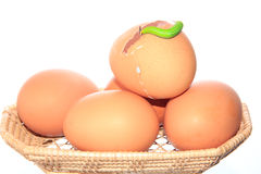 Chicken eggs and green worm Stock Photos