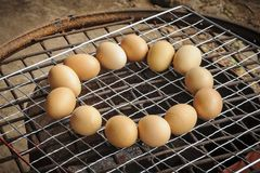 Chicken eggs Grilled over stove gridiron. Stock Image