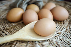 Chicken eggs in heap on cover basket Stock Photography