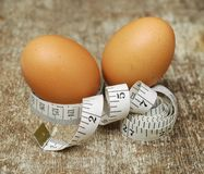 Chicken eggs on measurement tape Stock Images